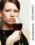 young woman with a wineglass... | Shutterstock . vector #155144417