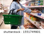 Woman With Shopping Basket In...