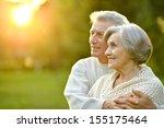 happy elderly couple at nature... | Shutterstock . vector #155175464