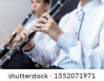 Boy Playing The Clarinet.a Man...
