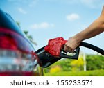 hand refilling the car with... | Shutterstock . vector #155233571