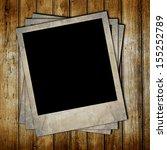 vintage photo frames on wooden... | Shutterstock . vector #155252789