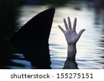 Hand In Ocean With Shark Fin.