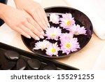 woman's hands at spa procedure | Shutterstock . vector #155291255