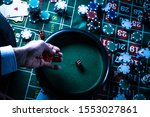 Casino background, poker Chips on gaming table, roulette wheel in motion, - stock photo