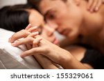 Stock photo young lovers kissing on the couch focused on hand 155329061