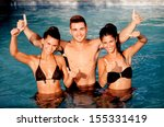 three happy friends in the pool ... | Shutterstock . vector #155331419