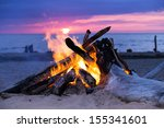 blazing bonfire on the beach | Shutterstock . vector #155341601