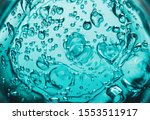 Small photo of Water blue gel balls. Polymer gel. Silica gel. Balls of blue hydrogel. Crystal liquid ball with reflection. Texture background. Close up macro. Soapsuds background with air bubbles