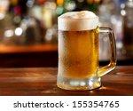 cold mug of beer  | Shutterstock . vector #155354765