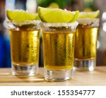 glass of tequila with lime | Shutterstock . vector #155354777