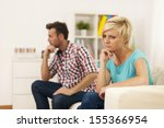 unhappy young couple sitting in ... | Shutterstock . vector #155366954