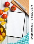 tomatoes with blank recipe book - stock photo