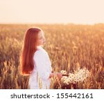 girl in the wheat field with... | Shutterstock . vector #155442161