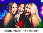 Portrait Of Happy Girls Singing ...