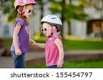 little girls ready to ride a... | Shutterstock . vector #155454797