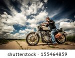 Biker In Sunglasses And Leathe...