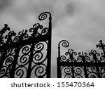 Black Gates Against Sky