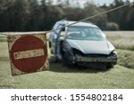 Damaged car and stop sign at one shot