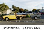 Small photo of Inconsiderate parking, a pick up truck and trailer parked across three push chair and baby parking bays. New Zealand.
