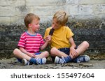 two brothers sharing an ice... | Shutterstock . vector #155497604
