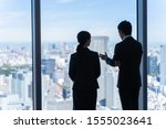 young asian businesspeople... | Shutterstock . vector #1555023641