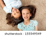 little girls laying on the... | Shutterstock . vector #155549549