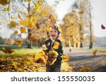 Little Toddler Boy In Autumn...
