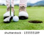 Golf Player At The Putting...