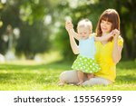mother and daughter in the park | Shutterstock . vector #155565959