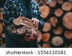 Man Hands Holding Firewood....