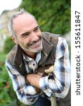 portrait of senior gardener in... | Shutterstock . vector #155611847