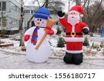 Two Inflatable Figures Snowman...