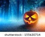 A Glowing Jack O Lantern In A...