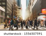 Blurred Crowd of unrecognizable business people walking on Zebra crossing in rush hour working day, blur business and people, lifestyle and leisure concept,