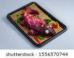 Stock photo herring fillet under beet root mash and mayonnaise coating 1556570744