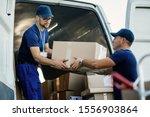Delivery Men Loading Carboard...