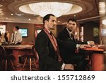 two young men in suits behind... | Shutterstock . vector #155712869