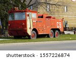 Denmark, Wisconsin / USA - November 9th, 2019: Vintage old US Air Force Airport Crash Rescue Fire Truck sits in front of Antique Shop.