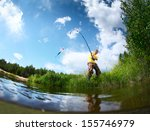 young man fishing in a pond in... | Shutterstock . vector #155746979