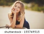 Young Smiling Woman Outdoors...