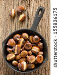Roasted Chestnuts On Wooden...