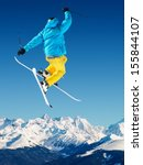 jumping skier in high mountains | Shutterstock . vector #155844107