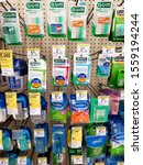 Small photo of Wilmington, Delaware, U.S.A - November 7, 2019 - Selection of tooth floss on the shelves