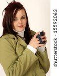 a woman holding a coffee mug | Shutterstock . vector #15592063