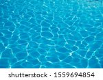 Surface Of Blue Swimming Pool...