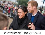 Small photo of Cardiff, Wales, UK, January 18th 2018. Prince Harry and his fiance Meghan Markle greet schoolchildren on their arrival at Cardiff Castle.