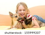 Stock photo laughing girl with pets 155999207