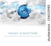 Christmas Ornaments On Snow...
