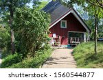 Small photo of Christiania, Denmark - 08/25/2019: Houses and lifestyle in Christiania, Copenhagen (Redan 4, 5, 6). Sunny summer day. Stadsgraven.